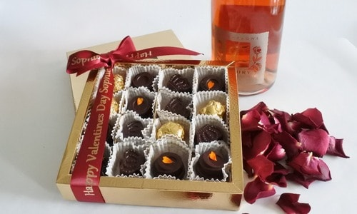 Romantic chocolates, pink champagnes and rose petals